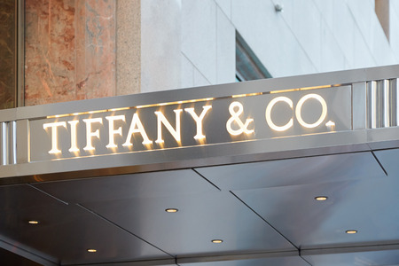 Tiffany e Co. shop sign Fifth Ave illuminated on September 12, 2016 in New York. Tiffany is an American internationally renowned luxury jewelry retailer.
