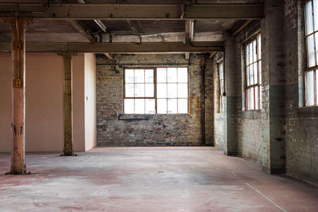 Photo pour Empty warehouse office or commercial area, industrial background - image libre de droit