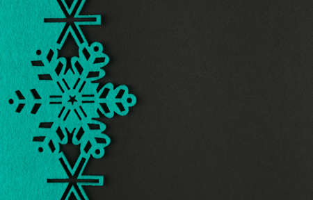 Unusual design christmas background with turquoise snowflakes and copy space on dark grey background