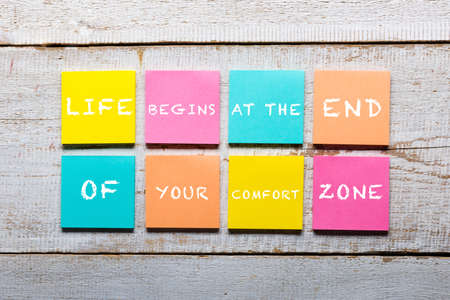 Photo for Retro white wooden table with motivational quote on colorful sticky notes - Royalty Free Image
