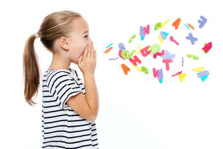 Foto de Cute little girl in stripped T-shirt shouting out alphabet letters. Speech therapy concept over white background. - Imagen libre de derechos