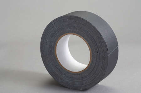 Roll of gaffer tape on grey background