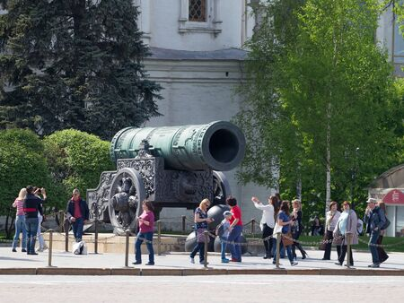Moscow - May 7, 2016: Many tourists are photographed near the Tsar Cannon at the Kremlin territrii May 7, 2016, Moscow, Russia