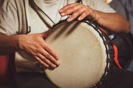 Photo for The drummer plays the ethnic percussion musical instrument djembe. - Royalty Free Image