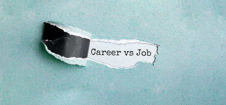 The text CAREER VS JOB appearing behind torn brown paper