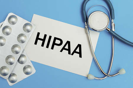 Photo pour Card with the inscription HIPAA The Health Insurance Portability and Accountability Act of 1996, stethoscope and pills, top view - image libre de droit