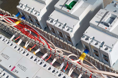Electrical wires or cables are laid in a cable channel and connected to circuit breakers and modular magnetic contactors. Circuit breakers, contactors are fixed to the panel in the electrical Cabinet.