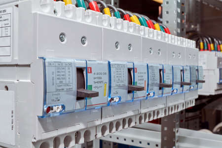 A range of large industrial electric circuit breakers. Modern reliable electrical equipment to protect electrical networks. Professional Assembly of electrical cabinets. Modern production.