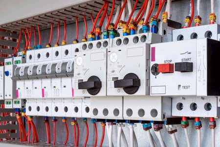 The electrical control panel are circuit breakers protecting the motor and relay. Circuit breakers with rotary handles and push-button and arranged in a row. Wires with ferrules number coded.