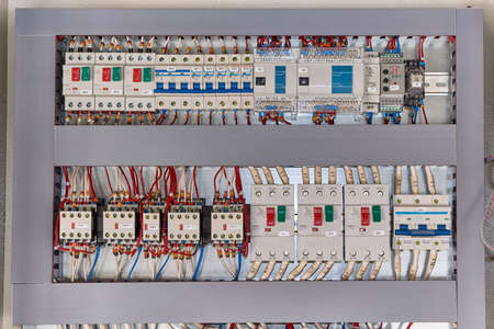 Motor protection circuit breakers, remote access controller, phase and voltage control relays, thermostat and contactors with front additional contacts in the electrical Cabinet.