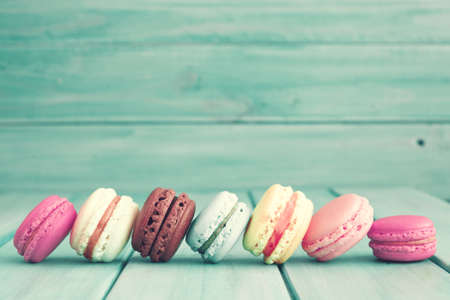 Colorful macaroons over turquoise wood