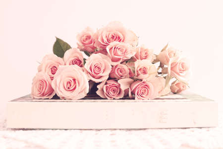 Bouquet of vintage roses over a box