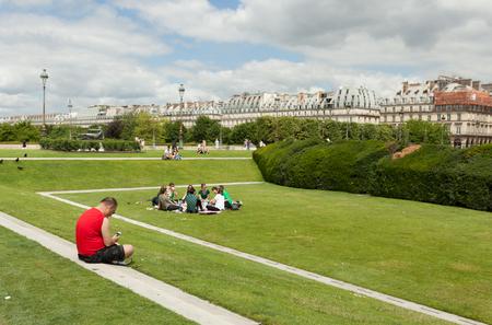 Paris, France 02 June 2018: People enjoying a beautiful summer day in the Park Jardin des Tuileries pl. de la Concorde