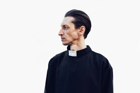 Photo pour Portrait of handsome catholic priest or pastor with collar Standing isolated on the white background - image libre de droit