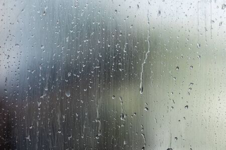 Photo pour Water drops on window glass surface with blured nature background. Abstract weather concept - image libre de droit
