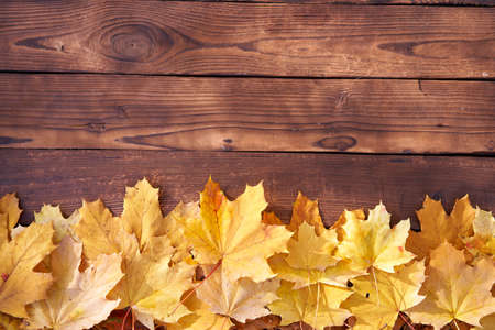 Photo pour Autumn leaves frame on wooden background top view Fall Border yellow and Orange Leaves vintage wood table Copy space for text - image libre de droit