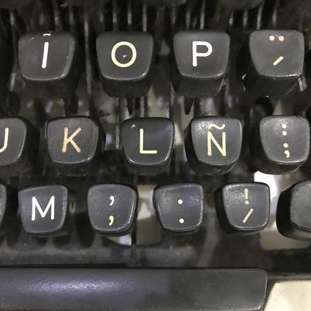 Closeup of a white and black vintage typewriter