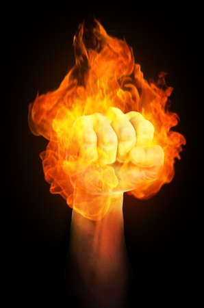 A strong holding fist is on fire
