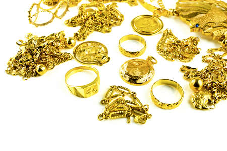 Gold in varies jewelry form on white isolated background