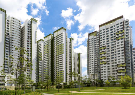 A horizontal shot of a park leading to a green estate in Singapore
