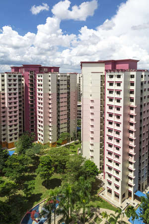 A vertical shot of a pink estate with park and playground