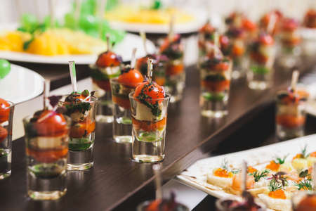 Catering for party. Close up of sandwiches, appetizers and fruit