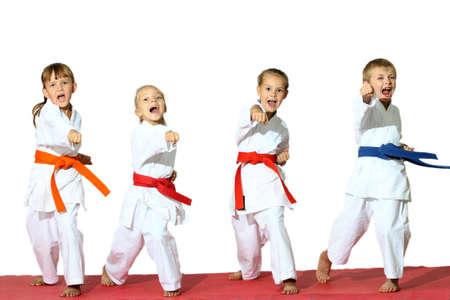 Four children in kimono hit a punch