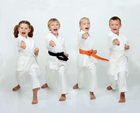 Cheerful kids practicing taekwando