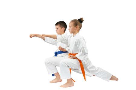 Children are beating the blow gyaku-tsuki in racks of karate