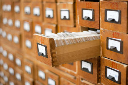 Old wooden card catalogue with one opened drawer