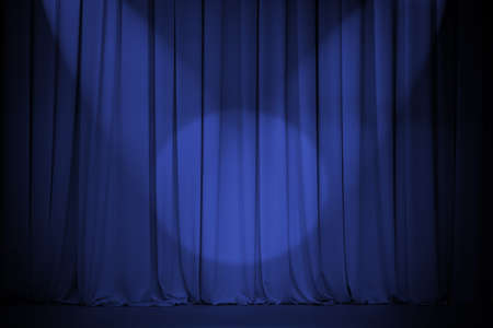 theater blue curtain with two lights cross