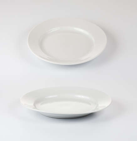 Set of round plates or dishes on white background