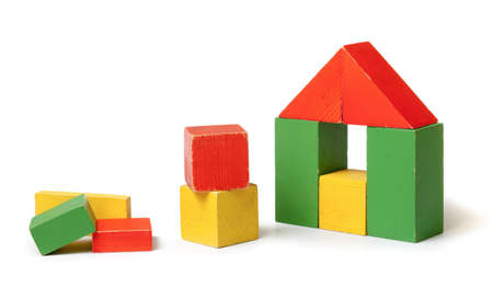 Simple house made from colorful wooden building blocks