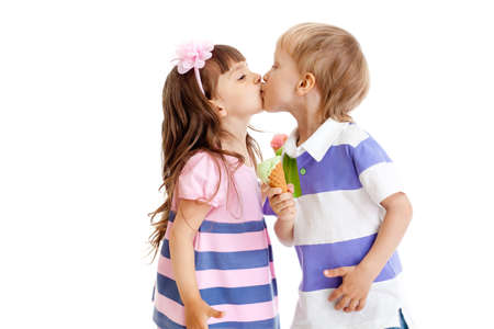Photo for girl and boy are kissing with ice cream in hands isolated - Royalty Free Image