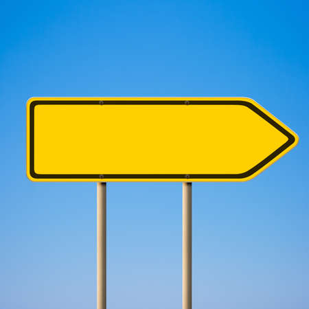 Blank yellow road sign, direction pointer to right against blue sky