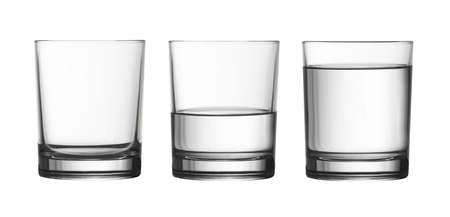 low empty, half and full of water glass isolated on white