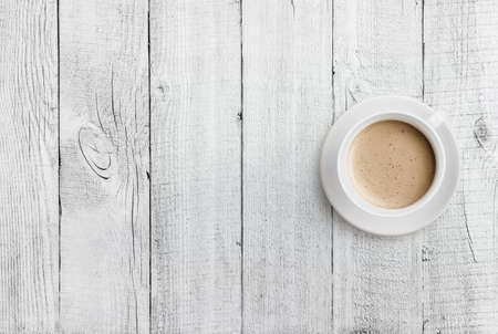 Photo for coffee cup top view on white wood table background - Royalty Free Image