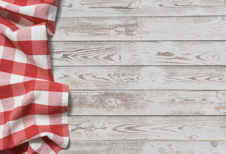 Photo pour red folded tablecloth with white wooden table - image libre de droit