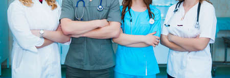 profession medicine staff. multinational people - doctor, nurse and surgeon. a group of faceless doctors. medical advertisement design. background wide promotional banner