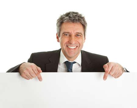 Confident businessmen presenting empty board
