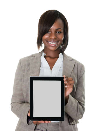 Confident female executive displaying a touchscreen pc isolated on white background.