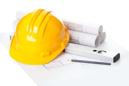 Photo pour Image of  blueprints with level pencil and hard hat on table - image libre de droit