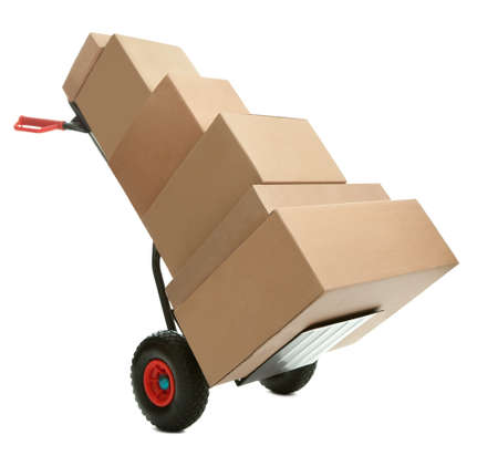 Hand truck with cardboard boxes on it ready for delivery over white background