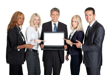 Successful business team displaying a laptop isolated on white background