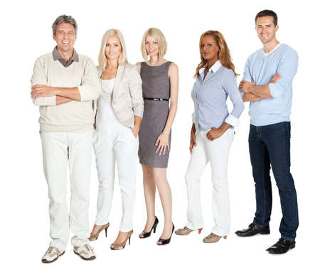 Portrait of business group standing confidently on white background