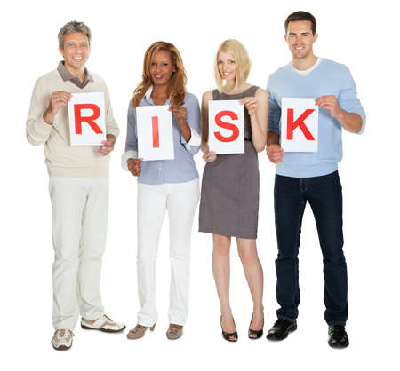 Portrait of happy group of people holding sign board illustrating risk on white background