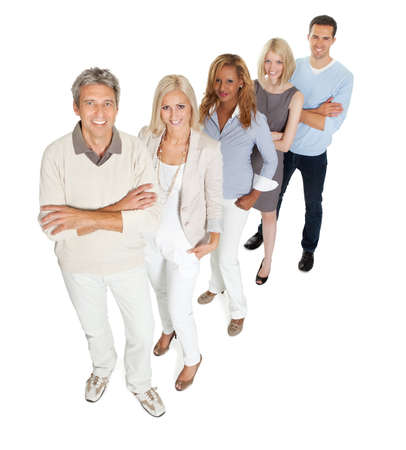 Portrait of creative business team standing in line on white background