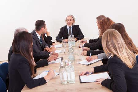 Portrait Of A Serious Business Men And Women Attending A Seminar