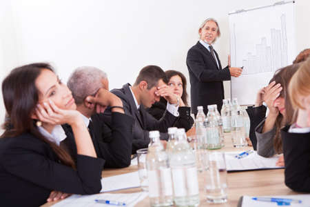 Photo Of Sad Business Team Attending The Seminar