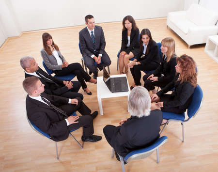 Group Of Business People Sitting On Chair Attending The Meeting